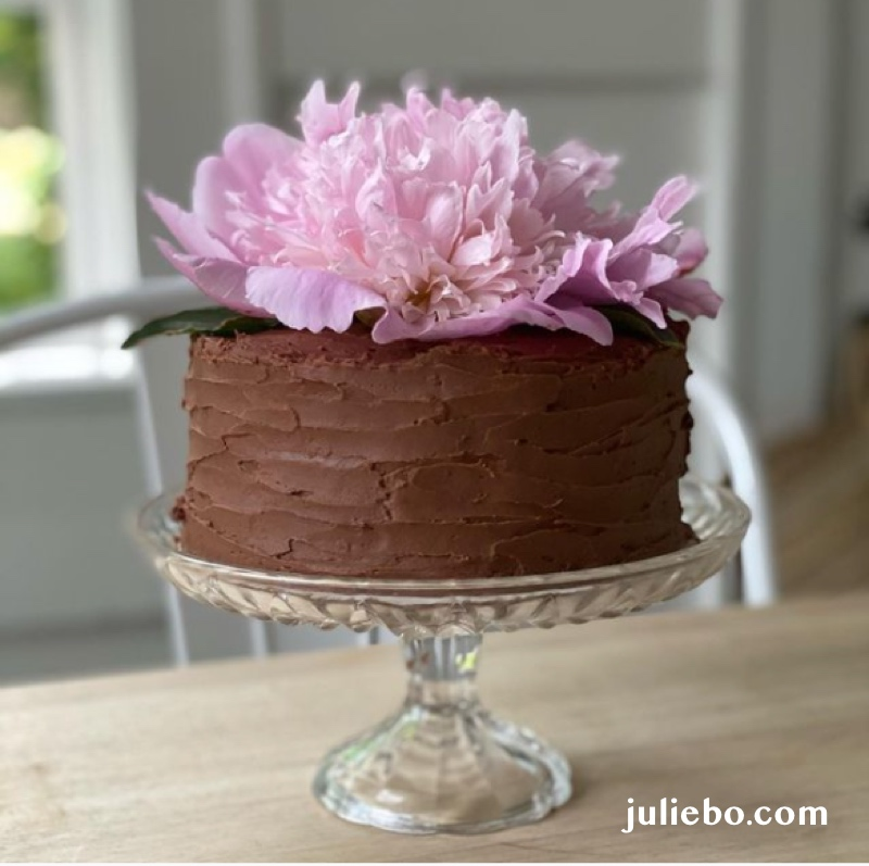 This peony adorned cake is a petite classic yellow cake with sprinkles folded into the batter and chocolate fudge frosting is just the right size for one gorgeous bloom.